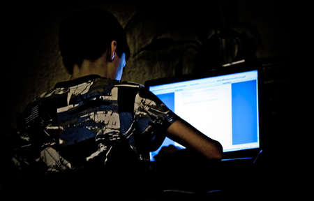 computer writing: boy with laptop, light n shade