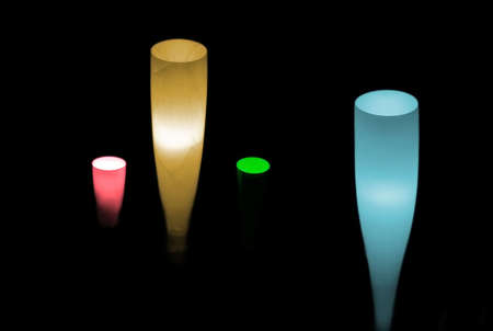 electrolier: row of colorful stand lamps in dark