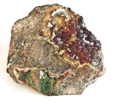 colored Garnets- gem, crystallization on rock photo