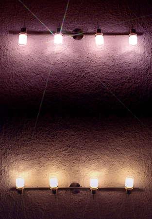 lanterns on shaded wall photo