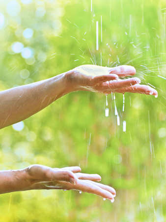 hands with raindrops. photo