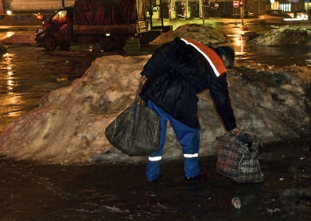miry: a street cleaner at winter