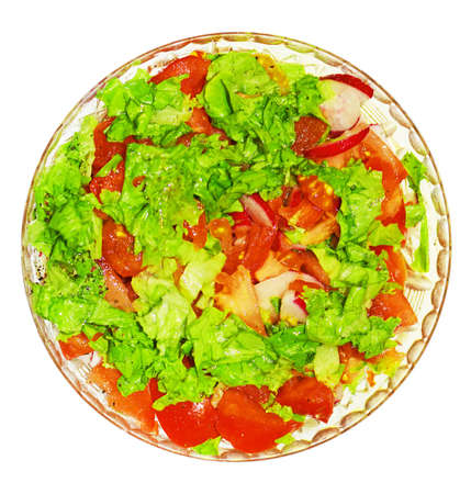 plateful: salad with tomatoes, radish, lettuc, spices, oil