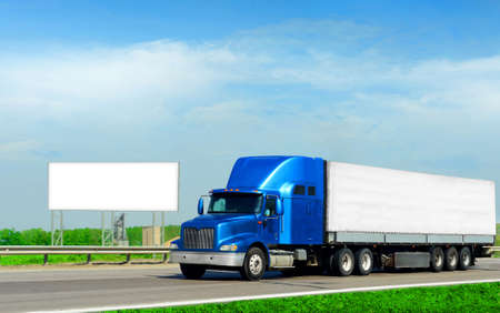 truck on highway: cargo truck and road billboard Stock Photo