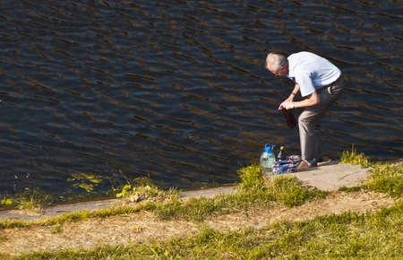 pensionary: oldman filling the bottles