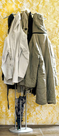 overcoat: full coat rack