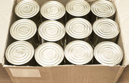 canned goods: canned production in carton box Stock Photo