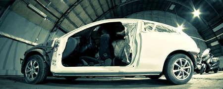 storing: car under repair in garage