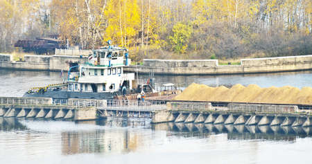 laden: sand laden tow barge Stock Photo
