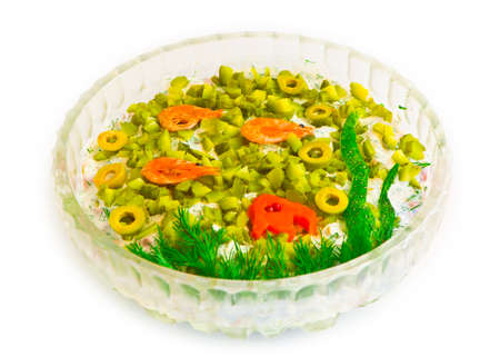 plateful: salad with cut olives, shrimps, vegetables, mayonnaise