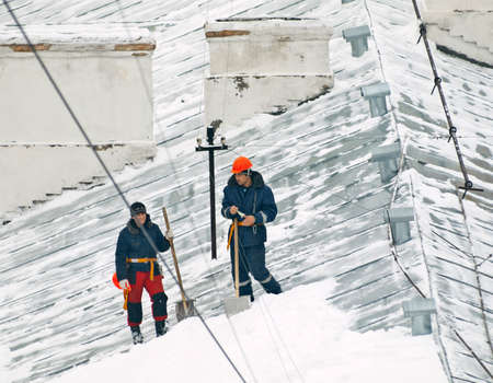 snow removers on rooftop