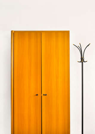 lacquered: wardrobe and coat-rack Stock Photo
