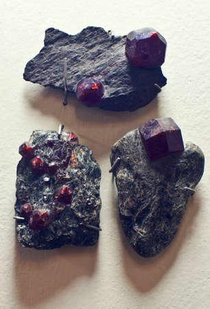 gemology: crystals of Almandine (Garnet) in host rock