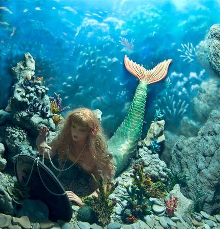 zeemeermin met spiegel Stockfoto
