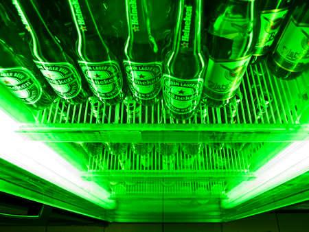 beer production: Heineken netherlandian beer inside illuminated shop- refrigerator