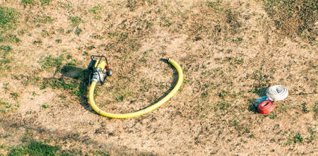 petrol powered: petrol powered pump and hoses on ground