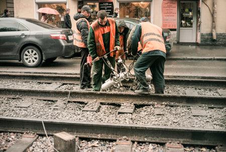 fettler: 2012, workers repairing tramways Editorial