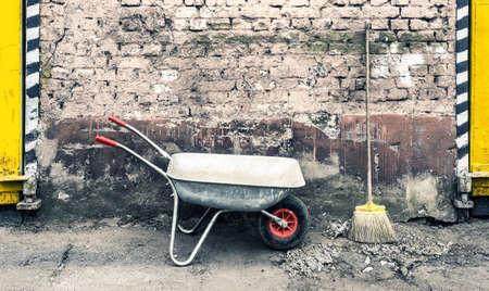 miry: hand cart near old wall