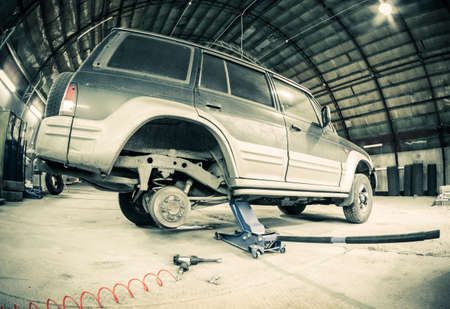lifting jack: tire fitting shop Stock Photo