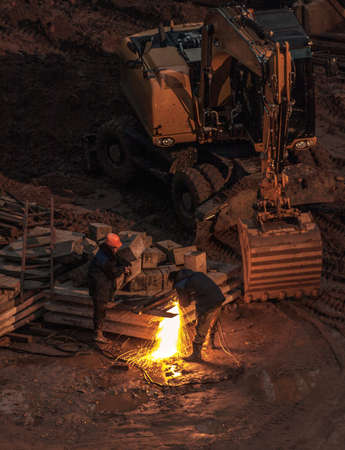 circ saw: construction site at night Stock Photo