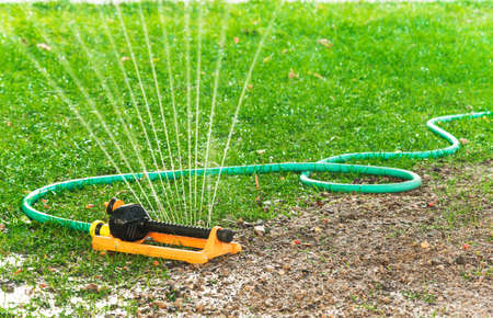 implements: garden sprinkler Stock Photo