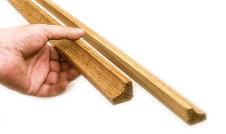 baseboard: hand holds the baseboard Stock Photo