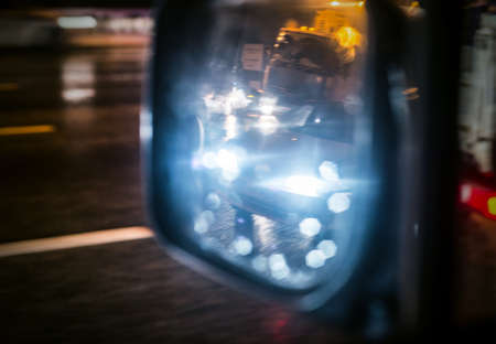 rearview: rear-view mirror at night