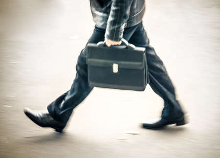salaried worker: blurry walking businessman