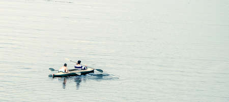 coupled: kayakers among big water
