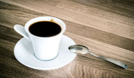 blak white: coffee cup on wooden table