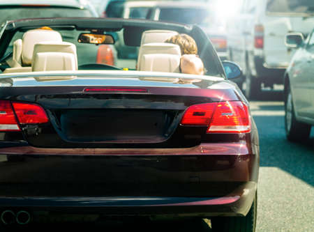 back in an hour: sport-coupe cabrio Stock Photo