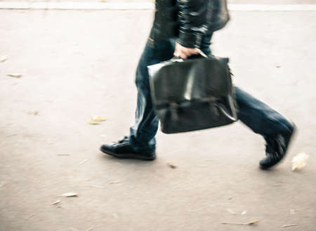salaried worker: businessman at blurry walking