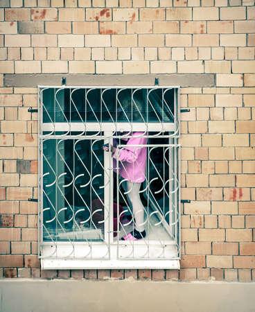 habitable: charwoman in opened window Stock Photo