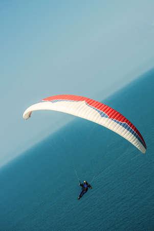 pilotage: hang-glider over sea Stock Photo