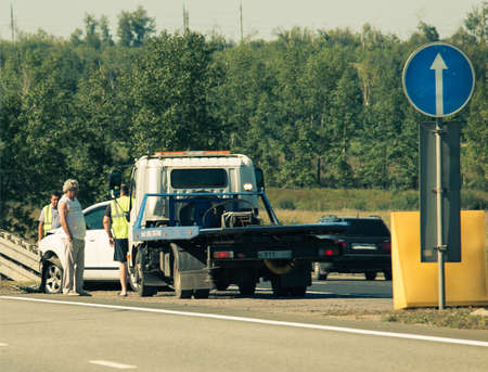 voronezh: M4, VORONEZH, RUSSIA, 2016: road accident, people and tow-truck near the broken car Editorial