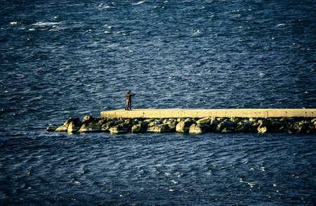 breakwater: young couple on the breakwater