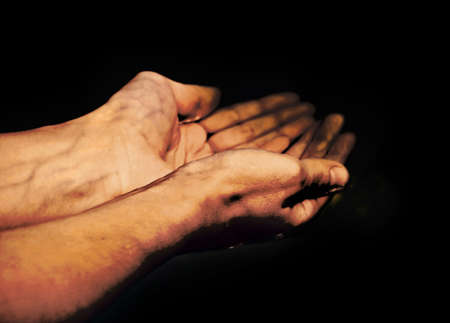 naphtha: hands in oil Stock Photo