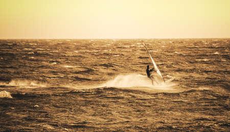 windsurfing at sunset Stock Photo