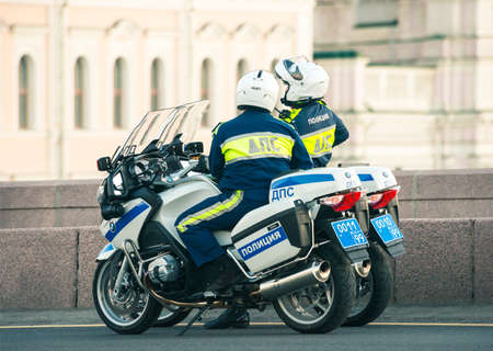 RUSSIA, 2015: traffic policemen on their patrol motorcycles Editorial