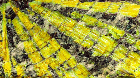 yellow crystal mines within enclosing rock Stock Photo