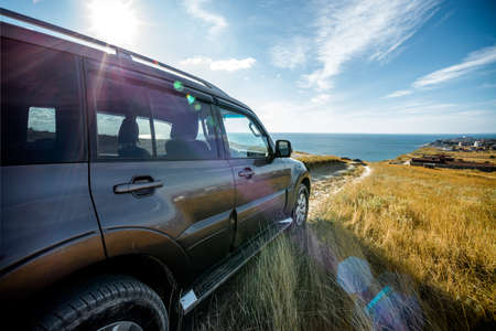 SUV moving down to the sea
