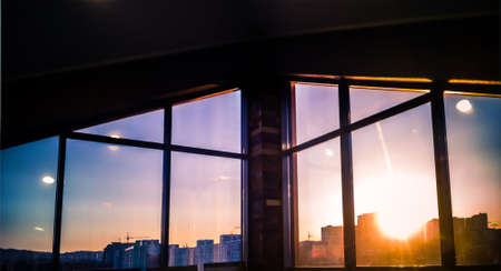 city sunset in mansard window Stock Photo