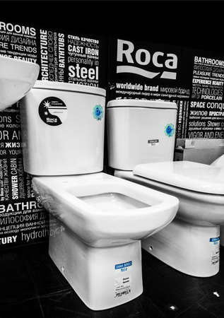 toilet seats are displayed at sanitary-ware manufacturers exposition. Roca, Spain