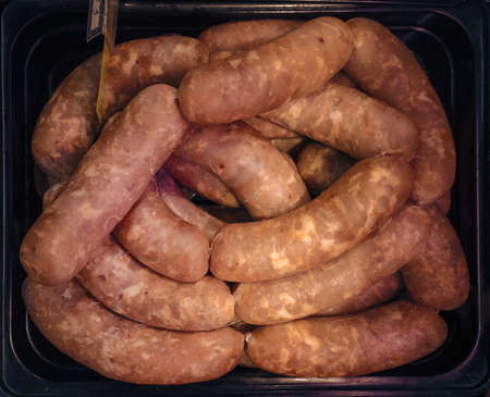 small sausages in container Stock Photo - 106012582