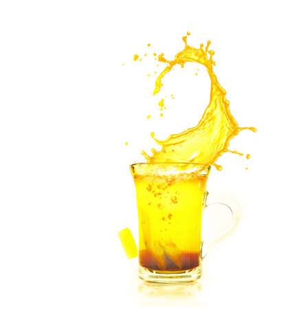 splashing brewing tea on white Stok Fotoğraf