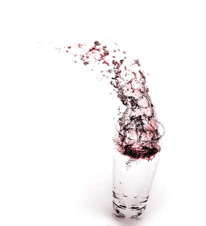 wine splashing in glass Imagens