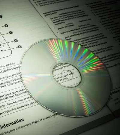 cd with its paper instruction Stock Photo