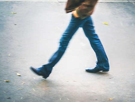man at blurry walking
