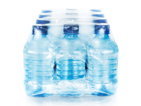 packed bottled water on white