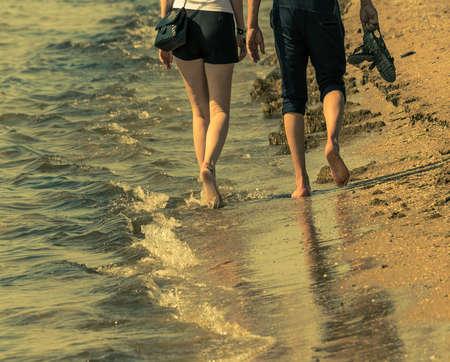 couple in the sea surf Banco de Imagens - 125950393